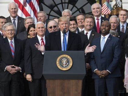 President Donald Trump joined by Senate Majority Leader Mitch McConnell of Ky., Vice President Mike Pence, Speaker of the House Paul Ryan, R-Wis., Sen. Tim Scott, R-S.C., front right, and other members of congress, speaks during an event on the South Lawn of the White House in Washington, Wednesday, Dec. …