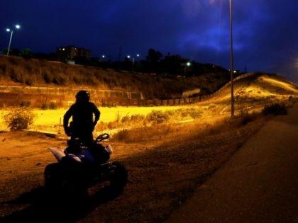 Border Patrol agent on ATV in San Diego Sector