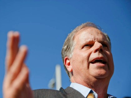 Alabama Democrat Senate candidate Doug Jones speaks to the media, Tuesday, Nov. 14, 2017, in Birmingham, Ala. Jones runs against former judge Roy Moore. (AP Photo/Brynn Anderson)