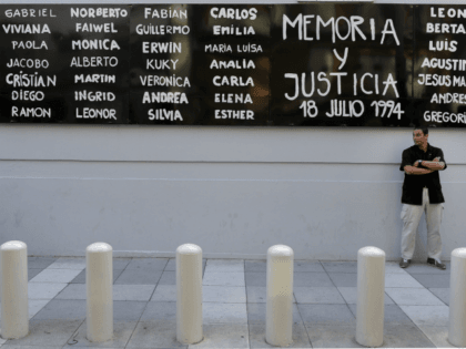 A man stands guard in front of the headquarters of AMIA (Argentine Israelite Mutual Association), in Buenos Aires on January 21, 2015, to protest against the death of Argentine public prosecutor Alberto Nisman, who was found shot dead earlier, just days after accusing President Cristina Kirchner of obstructing a probe …