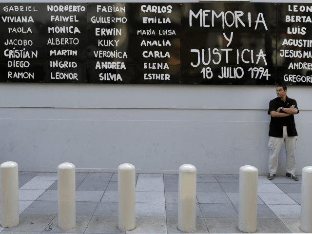 A man stands guard in front of the headquarters of AMIA (Argentine Israelite Mutual Association), in Buenos Aires on January 21, 2015, to protest against the death of Argentine public prosecutor Alberto Nisman, who was found shot dead earlier, just days after accusing President Cristina Kirchner of obstructing a probe into a 1994 Jewish center bombing. Nisman, 51, who was just hours away from testifying at a congressional hearing, was found dead overnight in his apartment in the trendy Puerto Madero neighbourhood of the capital. 'I can confirm that a 22-caliber handgun was found beside the body,' prosecutor Viviana Fein said. The nation's top security official said Nisman appears to have committed suicide. AFP PHOTO/ALEJANDRO PAGNI (Photo credit should read ALEJANDRO PAGNI/AFP/Getty Images)
