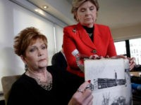 Beverly Young Nelson, left, and attorney Gloria Allred hold Nelson's high school yearbook, which they say was signed by Senate candidate Roy Moore, at a news conference in New York on Monday. (Richard Drew/AP)