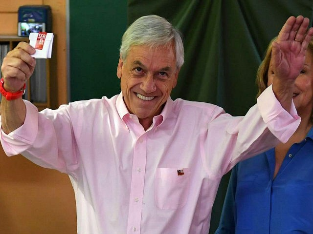 Chile's presidential candidate Sebastian Pinera (L) prepares to cast his vote, next to his wife Cecilia Morel, during the presidential run-off election in Santiago, Chile on December 17, 2017. About 14 million people are eligible to cast ballots at more than 43,000 polling stations, but the outcome of Sebastian Pinera's …