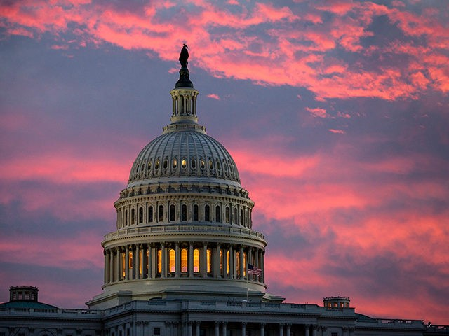 FILE - In this Thursday, Nov. 30, 2017, file photo, the sky over The Capitol is lit up at dawn as Senate Republicans work to pass their sweeping tax bill, in Washington. Congress' last major tax overhaul, three decades ago, was everything this year's version isn't. The Tax Reform Act …