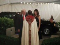 President Donald Trump and first lady Melania are greeted by the Rev. James R. Harlan as they arrive for Christmas Eve service at the Church of Bethesda-by-the-Sea in West Palm Beach, Fla., Sunday, Dec. 24, 2017. (AP Photo/Carolyn Kaster)