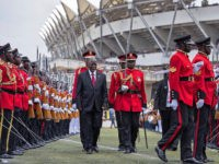 Tanzania's newly elected president John Magufuli (C, L) reviews troops during the swearing in ceremony in Dar es Salaam, on November 5, 2015. John Magufuli won in the October 25 poll with over 58 percent of votes cemented the long-running Chama Cha Mapinduzi (CCM) party's firm grip on power.. AFP …