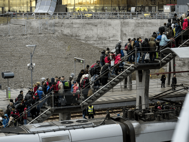 Police organize the line of refugees on the stairway leading up from the trains arriving from Denmark at the Hyllie train station outside Malmo, Sweden, November 19, 2015. 600 refugees arrived in Malmo within 3 hours and the Swedish Migration Agency said in a press statement that they no longer …