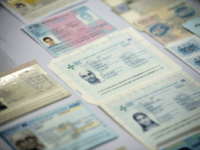Fake passports are displayed at the immigration bureau in Bangkok on February 10, 2016 after Thai police broke up a major fake passport ring led by an Iranian known as 'The Doctor' which sent thousands of passports to Middle Eastern customers trying to enter Europe. Five years of investigation culminated …