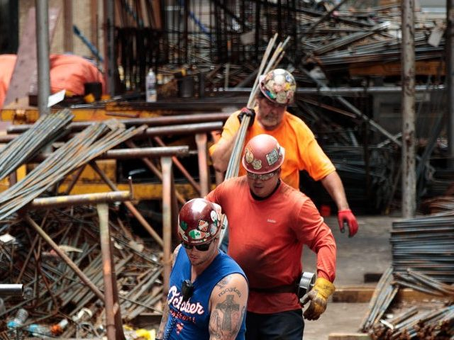NEW YORK, NY - AUGUST 16: Construction laborers work on the site of a new residential building in the Hudson Yards development, August 16, 2016 in New York City. Home construction in the U.S. accelerated in July to the fastest pace in five months. While housing starts were up 2.1 …