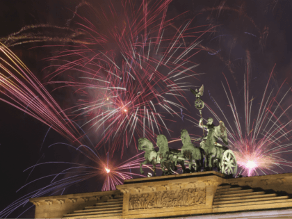 BERLIN, GERMANY - JANUARY 01: Fireworks explode behind the Brandenburg Gate at midnight on January 1, 2017 in Berlin, Germany. Security was tightened this year at the celebration at the location after 12 people were killed and another 48 injured when a truck was driven into a Christmas market nearby …
