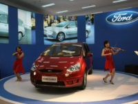 NANJING, CHINA - MAY 1: (CHINA OUT) Models play violins beside a Ford S-MAX during a family car fair on May 1, 2007 in Nanjing of Jiangsu Province, China. Cars with an engine size of less than 1.6 liters accounted for 60 percent of Chinese vehicle sales last year. The sales of low-emission cars have risen due to high oil prices and government policies favoring small cars, according to a report from the China Association of Auto Manufacture. (Photo by China Photos/Getty Images)