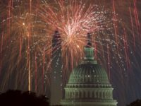 Fireworks explode over the National Mall as the US Capitol (R) and National Monument are seen on July 4, 2017, in Washington, DC. / AFP PHOTO / PAUL J. RICHARDS (Photo credit should read PAUL J. RICHARDS/AFP/Getty Images)