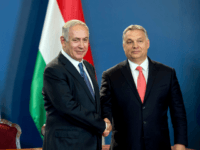 Israeli Prime Minister Benjamin Netanyahu (L) and his Hungarian counterpart Viktor Orban shake hands as they give a joint press conference at the parliament in Budapest, Hungary, on July 18, 2017. / AFP PHOTO / HUNGARIAN PRIME MINISTER'S OFFICE AND POOL / KAROLY ARVAI (Photo credit should read KAROLY ARVAI/AFP/Getty …