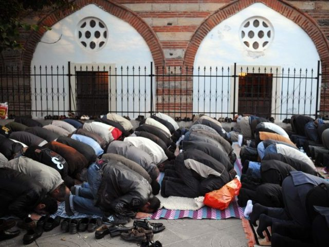 Muslim worshippers pray in front of a mosque in downtown Sofia on September 30, 2008, as they mark Eid al-Fitr at the end of the holy month of Ramadan. AFP PHOTO / DIMITAR DILKOFF (Photo credit should read DIMITAR DILKOFF/AFP/Getty Images)