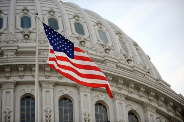 The US flag flies at the US Capitol in Washington, DC, January 20, 2009. Millions of people are expected to be in the US capital to witness the swearing of Barack Obama as 44th President of the United States. AFP PHOTO/Stan HONDA (Photo credit should read STAN HONDA/AFP/Getty Images)