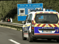 Police ride a car as they watch migrants walking along the A25 motorway in the direction of Dunkirk, on September 21, 2017, near Steenvoorde, northern France. The sprawling 'Jungle' camp -- which at its height was home to 10,000 people -- was dismatled in late 2016, but hundreds of people …