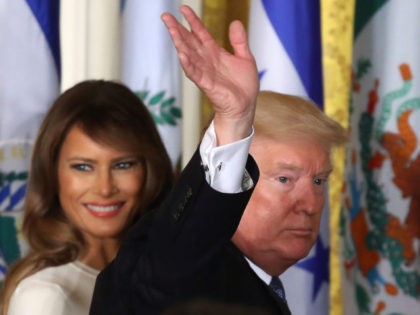 WASHINGTON, DC - OCTOBER 06: U.S. President Donald Trump and first lady Melania Trump depart from an event to celebrate Hispanic Heritage Month in the East Room at the White House, on October 6, 2017 in Washington, DC. (Photo by Mark Wilson/Getty Images)