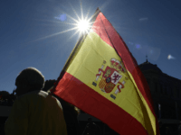 A man holding a Spanish flag arrives to take part in a demonstration calling for unity in Madrid on October 28, 2017, a day after direct control was imposed on Catalonia over a bid to break away from Spain. Spain moved to assert direct rule over Catalonia, replacing its executive …