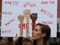 Victims of sexual harassment, sexual assault, sexual abuse and their supporters protest during a #MeToo march in Hollywood, California on November 12, 2017. Several hundred women gathered in front of the Dolby Theatre in Hollywood before marching to the CNN building to hold a rally. / AFP PHOTO / Mark …