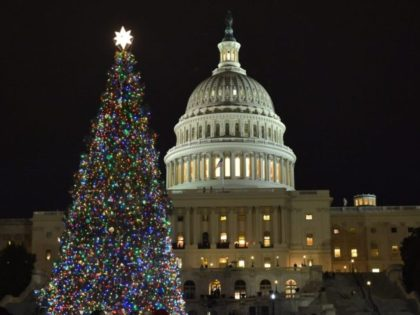 TOPSHOT - The Capitol Christmas tree is lit during a ceremony on the West Front of the US Capitol in Washington, DC on December 6, 2017. The Engelmann Spruce from the Kootenai National Forest in Montana will be lit from nightfall to 11 p.m. through January 1, 2018. / AFP …