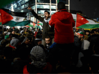 Protesters, one shouting slogans, wave Palestinian flags on December 12, 2017 during a demonstration in front of Berlin's main train station, to protest against the US decision to recognise Jerusalem as Israel's capital. US President Donald Trump's decision to recognise Jerusalem as Israel's capital, which marks a major departure from …