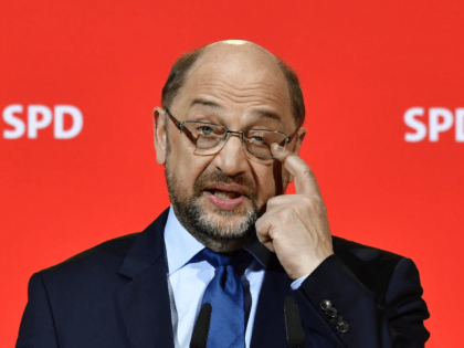 The leader of the Social Democratic Party (SPD), Martin Schulz gestures during a press conference on December 15, 2017 in Berlin. Leaders of the Social Democrats (SPD) meet on December 15, 2017 to approve the start of preliminary talks with German Chancellor's conservatives on ending the country's political deadlock. / …
