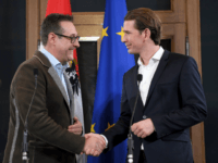 Leader of Austria's conservative People's Party (OeVP), Sebastian Kurz shakes hands with Chairman of the Freedom Party (FPOe), Heinz-Christian Strache after a joint press conference in Vienna, Austria on December 15, 2017. Austria's conservatives and the far-right announced on december 15, 2017 that they have agreed to form a coalition, …