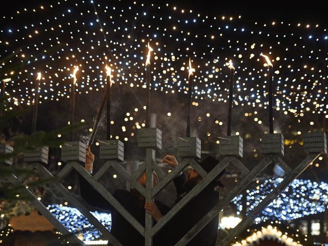 Rabbi Yehuda Teichtal (R) and the mayor of the Berlin district Charlottenburg - Wilmersdorf, Reinhard Naumann light the Hanukkah Menorah at Breitscheidplatz, one day ahead the anniversary of last year's deadly truck attack in Berlin, on December 18, 2017. Germany commemorates on December 19, 2017 victims of last year's devastating …