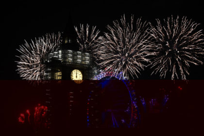 LONDON, ENGLAND - JANUARY 01: Fireworks explode over Big Ben as thousands gather to ring in the near year on January 1, 2018 in London, England. Crowds lined the banks of the River Thames in central London to see in 2018 with a spectacular fireworks display. After being silenced for …