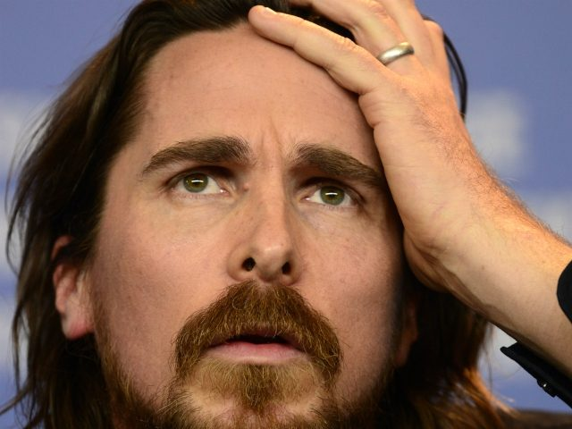 """British actor Christian Bale attends a press conference for the film """"Knight of Cups"""" presented in the competition of the 65th Berlin International Film Festival Berlinale in Berlin, on February 8, 2015. AFP PHOTO / JOHN MACDOUGALL (Photo credit should read JOHN MACDOUGALL/AFP/Getty Images)"""