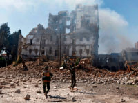 Huthi rebel fighters inspect the damage after a reported air strike carried out by the Saudi-led coalition targeted the presidential palace in the Yemeni capital Sanaa on December 5, 2017. Saudi-led warplanes pounded the rebel-held capital before dawn after the rebels killed former president Ali Abdullah Saleh as he fled the city following the collapse of their uneasy alliance, residents said. / AFP PHOTO / Mohammed HUWAIS (Photo credit should read MOHAMMED HUWAIS/AFP/Getty Images)
