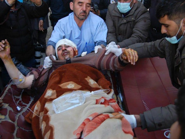 An injured Afghan man is transferred from an ambulance to a hospital following blasts at a Shiite cultural centre in Kabul on December 28, 2017. Around 40 people were killed and dozens more wounded when a suicide bomber blew himself up inside a Shiite cultural centre in Kabul on December …