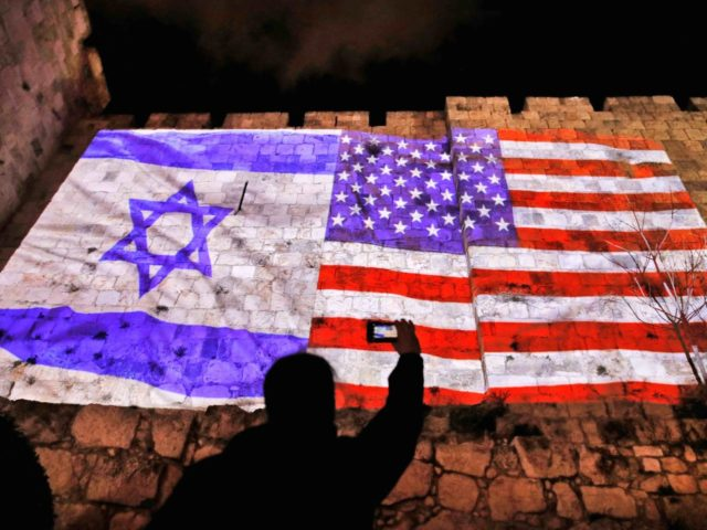 Israeli and American flag on Jerusalem wall (Ahmad Gharabli / AFP / Getty)