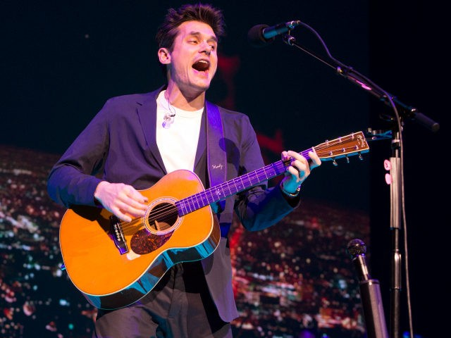"""John Mayer performs in concert during his """"The Search for Everything Tour"""" at The Wells Fargo Center on Friday, April 7, 2017, in Philadelphia. (Photo by Owen Sweeney/Invision/AP)"""
