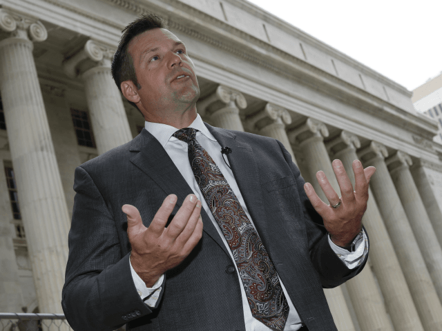 In this Aug. 23, 2016 file photo, Kansas Secretary of State Kris Kobach responds to questions outside the 10th U.S. Circuit Court of Appeals in Denver. A lawsuit by a former employee alleging that she was fired from Kobach's office because she didn't attend church enough is going to trial …