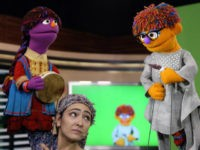The MacArthur Foundation has awarded $100 million to Sesame Workshop and the International Rescue Committtee to create a version of Sesame Street aimed at Syrian refugee children. Above: Characters from the Afghani version of the show that premiered this year. Rahmat Gul/AP