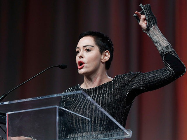 Actress Rose McGowan speaks at the inaugural Women's Convention in Detroit, Friday, Oct. 27, 2017. McGowan recently went public with her allegation that film company co-founder Harvey Weinstein raped her. (AP Photo/Paul Sancya)