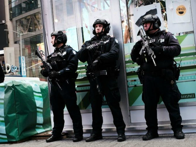 New York City police stand on a corner in Times Square, Dec. 12, 2017, in New York City.