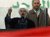 Beirut, LEBANON: Hezbollah second in command Naim Qassem addresses supporters outside the Serail, the seat of government, surrounded by anti-government protesters in Beirut 10 December 2006. Lebanese Prime Minister Fuad Siniora vowed his government would overcome the challenge posed by thousands of opposition protesters led by the Shiite militant group …