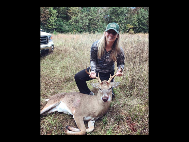 Avid hunter, lawyer Nikki Tate is shown here with one of her hunts.