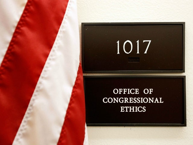 A sign for the Office of Congressional Ethics hangs on a wall October 30, 2009 in Washington, DC. A document from the House of Representatives ethics committee inadvertently placed on a publicly accessible computer network outlined investigations into the activities of 30 lawmakers from the House. The 22-page document, titled …