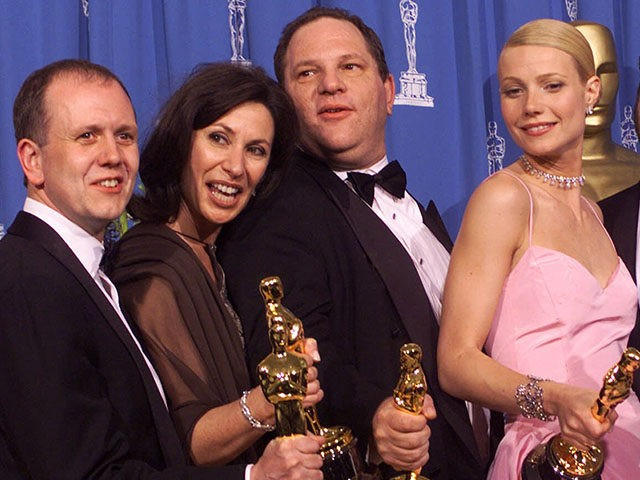 "From left to right, David Parfitt, Donna Gigliotti, Harvey Weinstein, Gwyneth Paltrow, Edward Zwick and Marc Norman all celebrate after receiving the Oscar for best picture for ""Shakespeare In Love"" during the 71st Annual Academy Awards Sunday, March 21, 1999, at the Dorothy Chandler Pavilion of the Los Angeles Music Center. Paltrow won the Oscar for best actress in the movie. (AP Photo/Dave Caulkin)"