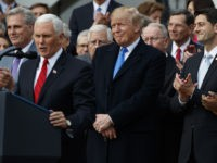 President Donald Trump smiles as Vice President Mike Pence speaks during an event on the South Lawn of the White House in Washington, Wednesday, Dec. 20, 2017, to acknowledge the final passage of tax overhaul legislation by Congress.Speaker of the House Rep. Paul Ryan, R-Wis., listens at right (AP Photo/Evan …
