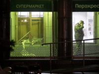 An investigator speaks on the phone inside a supermarket after an explosion in St.Petersburg on Wednesday. (Dmitri Lovetsky/AP)