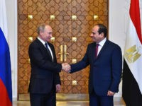 CAIRO, EGYPT - DECEMBER 11: (----EDITORIAL USE ONLY MANDATORY CREDIT - ' EGYPTIAN PRESIDENCY/ HANDOUT' - NO MARKETING NO ADVERTISING CAMPAIGNS - DISTRIBUTED AS A SERVICE TO CLIENTS----) Russian President Vladimir Putin (L) shakes hands with Egyptian President Abdel Fattah el-Sisi (R) during their meeting on December 11, 2017 at Presidential Ittihadiya Palace in Cairo, Egypt. Putin is on a one-day trip to Syria, Egypt and Turkey. (Photo by Egyptian Presidency / Handout/Anadolu Agency/Getty Images)