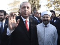 Turkish President Recep Tayyip Erdogan waves to the crowd as he goes to Minority School in the northeastern Greek town of Komotini, Friday, Dec. 8, 2017. Erdogan met Friday with members of Greece's Muslim minority on the second day of a visit to the country that saw tensions in bilateral relations resurface. (AP Photo/Giannis Papanikos)