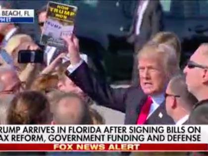 "Donald Trump holds up ""How Trump Won"" (Screenshot / Fox News)"