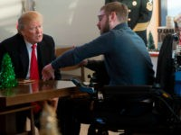US President Donald Trump meets with wounded veterans and their families at Walter Reed National Military Medical Center in Bethesda, Maryland, December 21, 2017. / AFP PHOTO / SAUL LOEB (Photo credit should read SAUL LOEB/AFP/Getty Images)