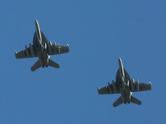 U.S. Air Force EA-18G Growler fighter jets fly over the Osan U.S. Air Base in Pyeongtaek South Korea Monday Dec. 4 2017. Hundreds of aircrafts including two dozen stealth jets began training Monday as the United States and South Korea launched their