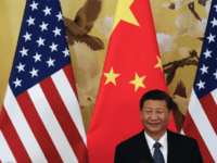"U.S. President Donald Trump waves next to Chinese President Xi Jinping after attending a joint press conference at the Great Hall of the People in Beijing. China's main official news agency is warning U.S.-Chinese relations will face ""more pressure and challenges"" following President Donald Trump's decision to label Beijing a …"